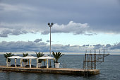 istock abandoned pier in a beach-resort 866656764
