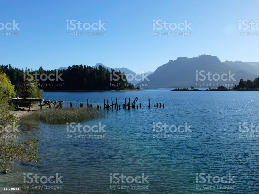 Abandoned pier on tranquil lake stock photo