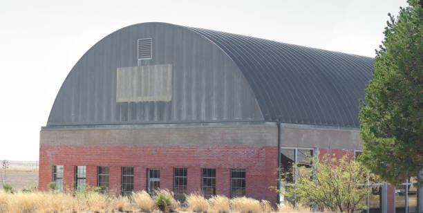 abandoned plane hangar exterior - aviation and environment summit stock photos and pictures