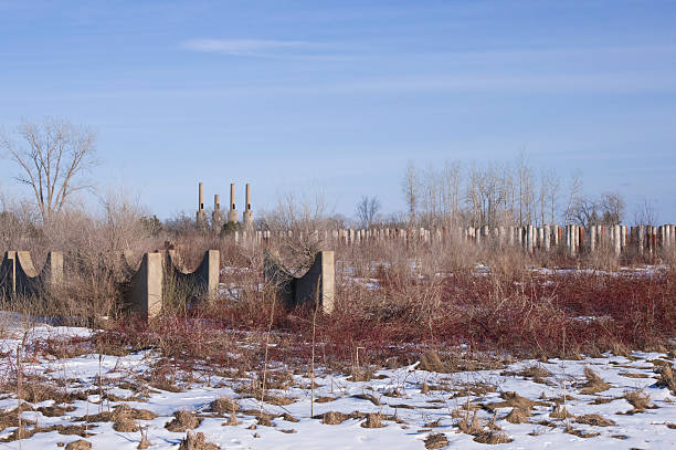abandoned plant and smokestacks - bioremediation stock photos and pictures