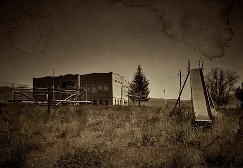 Abandoned Playground In Old Fashioned Photograph With Sepia Tones Stock Photo - Download Image Now