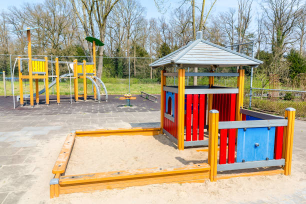 abandoned playground with play equipment - desolated stock pictures, royalty-free photos & images