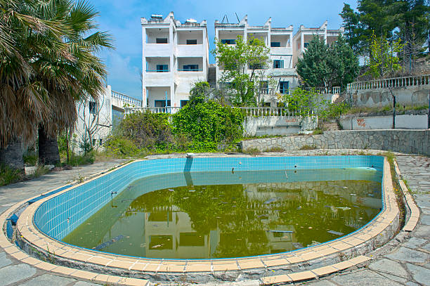 Abandoned pool amidst hotel ruins Ruins of a rundown empty hotel amidst stock pictures, royalty-free photos & images