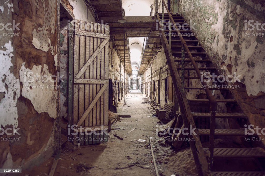 Abandoned prison cell walkway with old rusty stairs stock photo