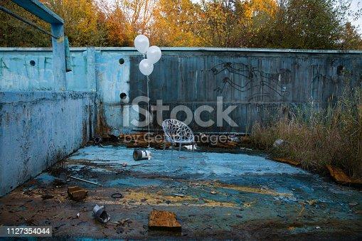 Abandoed swimming pool falling apart
