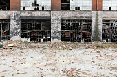 istock Abandoned red brick factory looking bombed out 1151594250