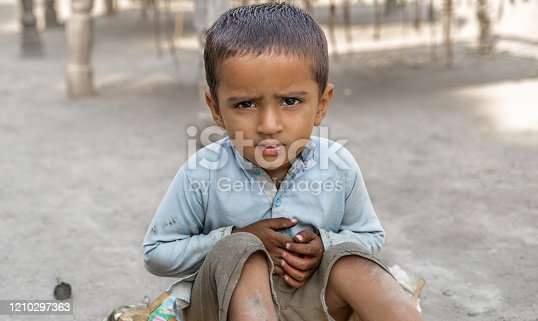 istock abandoned refugee boy in camp sad expressions and  his eyes are full of pain 1210297363