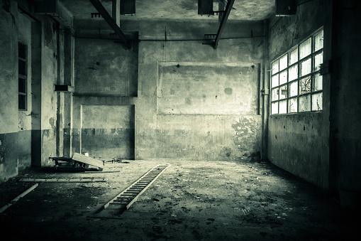 Abandoned room with broken window