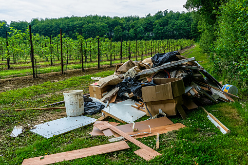 Fly tipping on an orchard