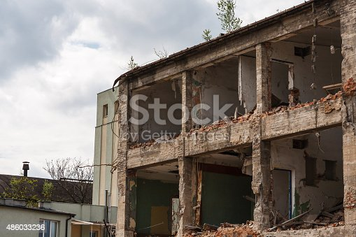 istock Abandoned ruined factory building 486033236