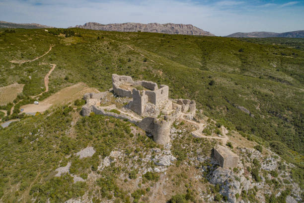 Abandoned ruins of the Aguilar Castle in France stock photo