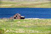 An old abandoned rustic wood ranch house barn on Separation Lake near Kamloops, British Columbia, Canada.