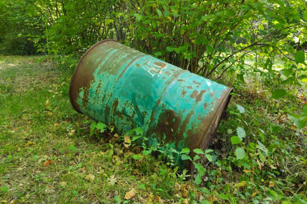Abandoned rusty oil barrel stock photo