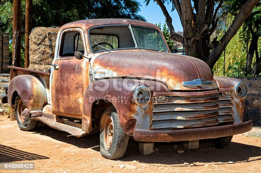 A rusty, abandoned, vintage American truck in Namibia.