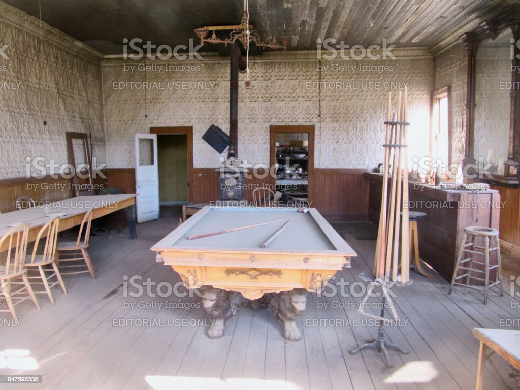 Abandoned saloon with billiard table of the ghost town Bodie stock photo
