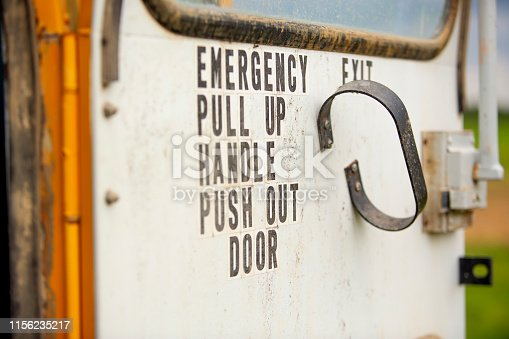 The emergency exit door of an abandoned school bus