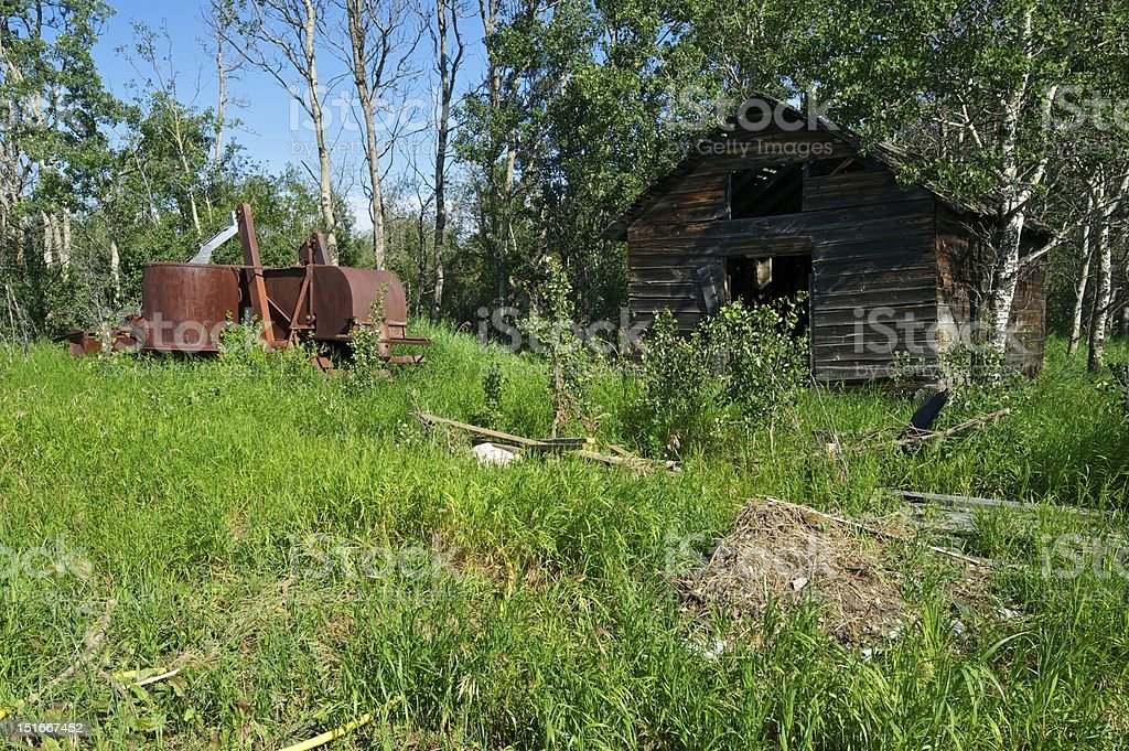 Abandoned shed and Combine harvester royalty-free stock photo