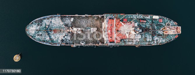 Aerial view of an abandoned freighter in the Atlantic.
