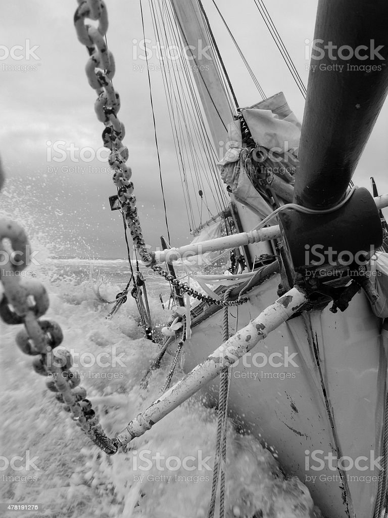 Abandoned Ship Tossed at Sea by Rough Waves stock photo
