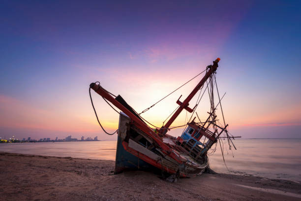 abandoned shipwreck of wood fishing boat - shipwreck stock pictures, royalty-free photos & images