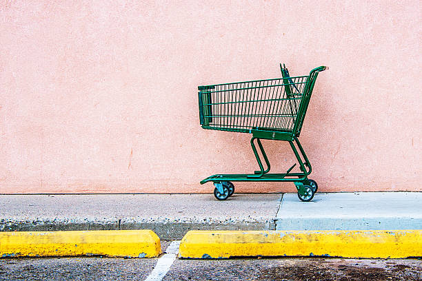 Abandoned Shopping Cart Abandoned Shopping Cart against Pink Wall derelict stock pictures, royalty-free photos & images