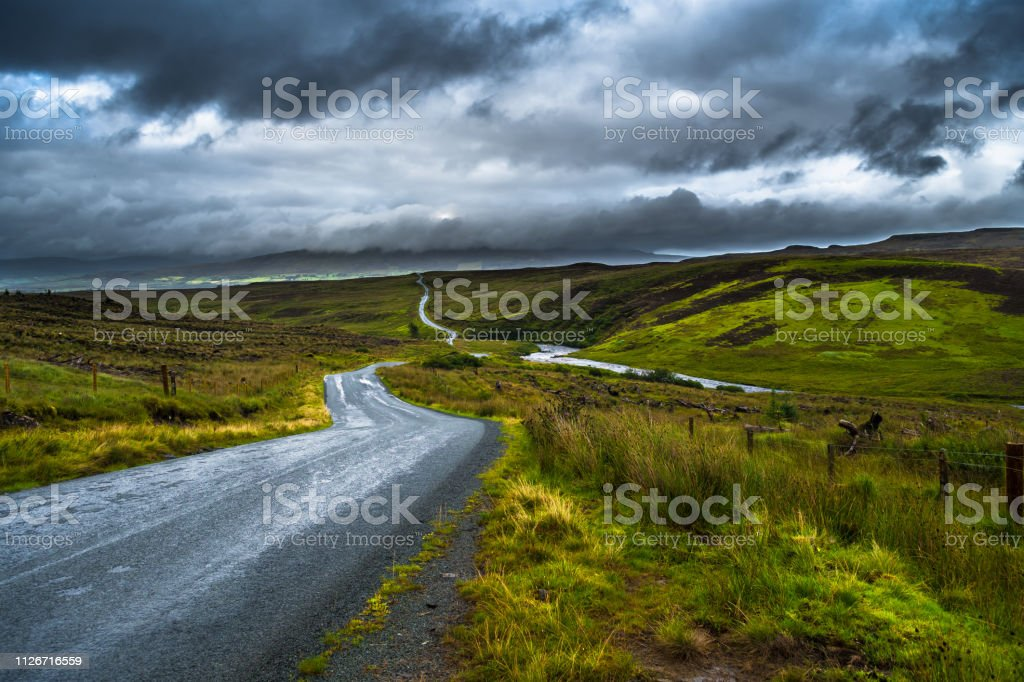 Abandoned Single Track Road Through Scenic Hills On The Isle Of Skye In Scotland stock photo