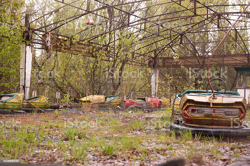 abandoned soviet style classic car carousel playgroung in amusem stock photo