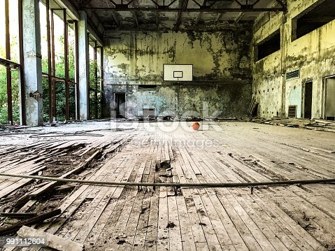 istock Abandoned sports hall 991112604