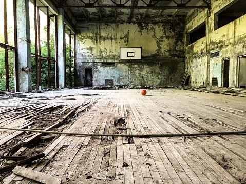istock Abandoned sports hall 991112604