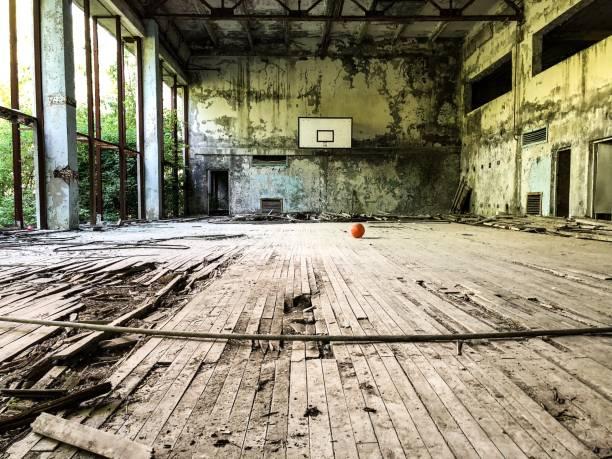 abandoned sports hall - город призрак стоковые фото и изображения