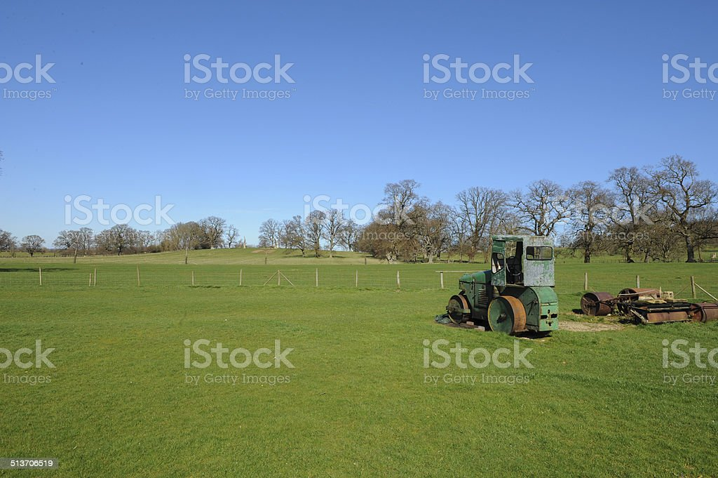 Rusty abandoned old steam roller at the Stanway Cricket Ground on a...