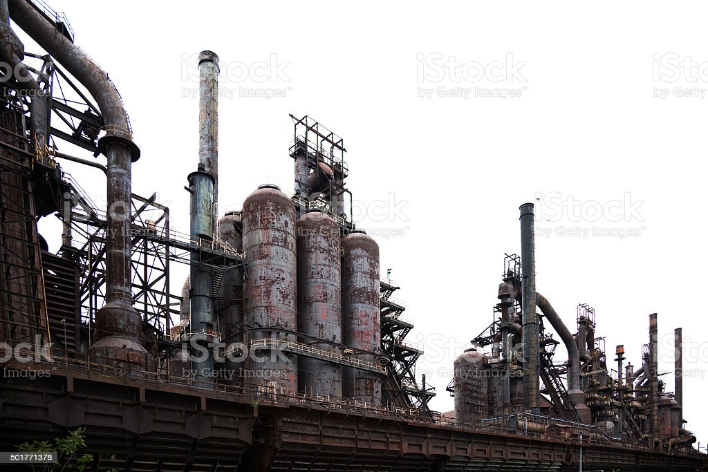 Abandoned steel mill blast furnace isolated on white stock photo