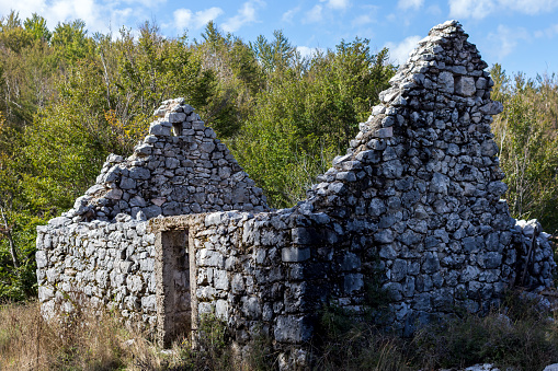 Abandoned stone house with no roof