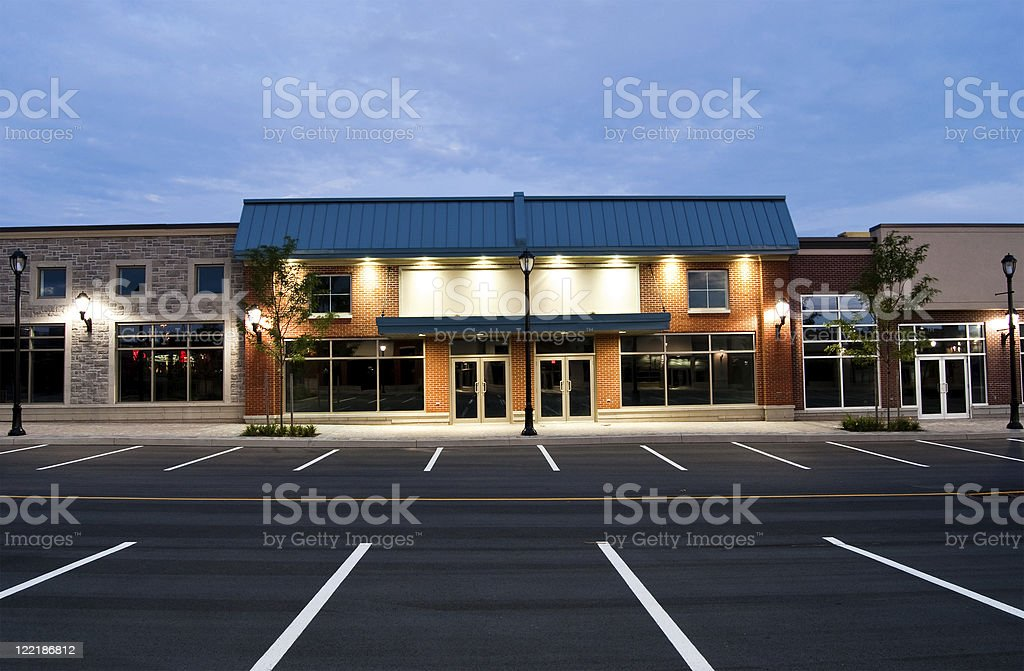 Abandoned Store Fronts in a New Strip Mall Development stock photo