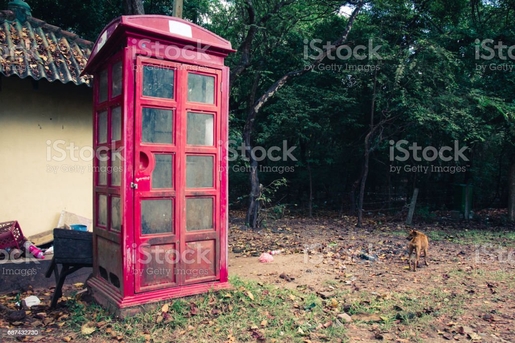 Abandoned telephone booth in the ancient city of Polonnaruwa, Sri Lanka. stock photo