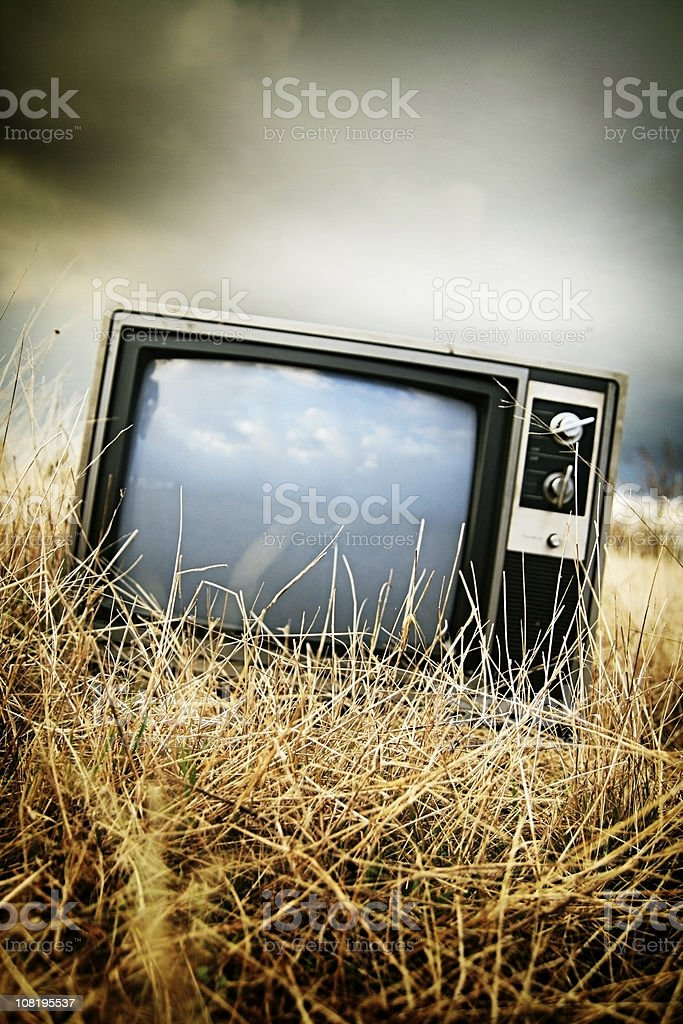 Abandoned Television In A Field with Copy Space stock photo