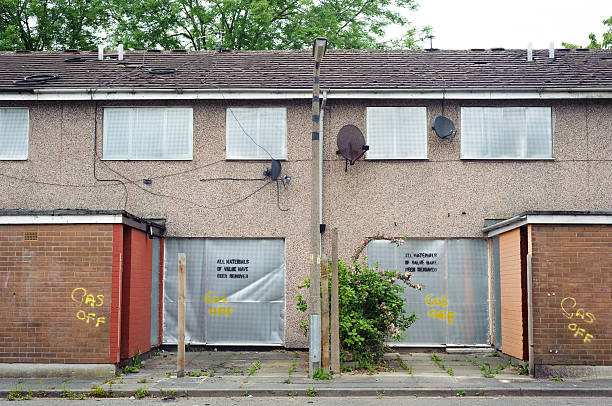 Abandoned terraced housing with metal shutters stock photo