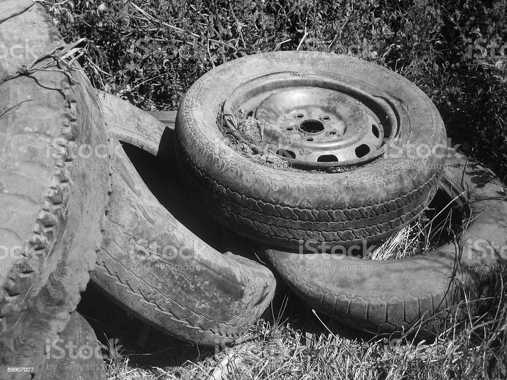 Abandoned Tires in Grass Closeup Black and White royalty-free stock photo