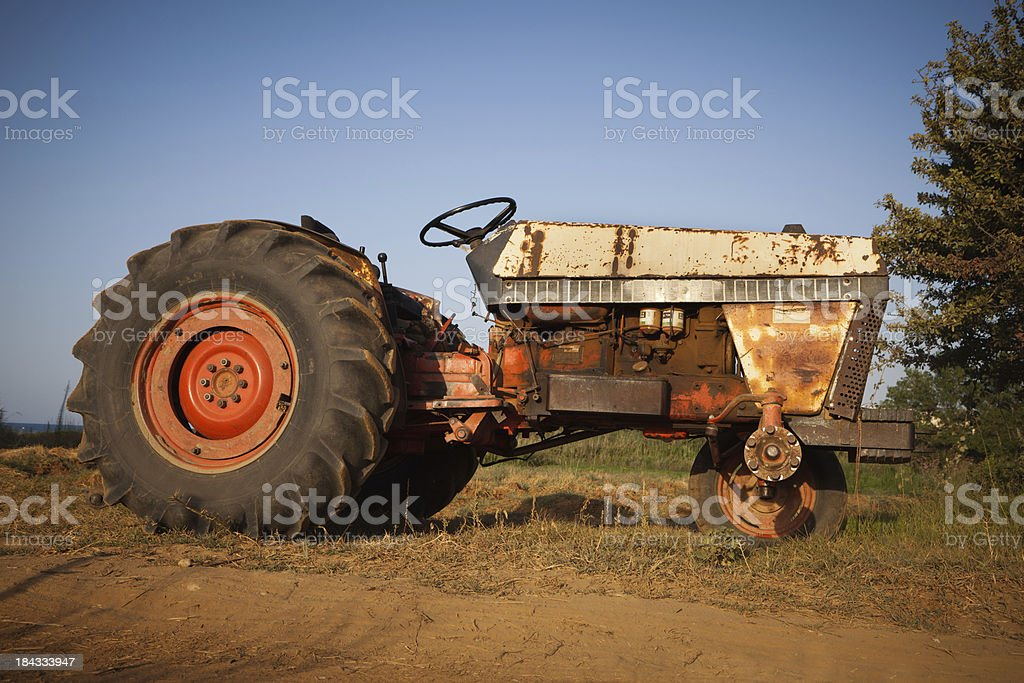 Abandoned tractor in a field royalty-free stock photo