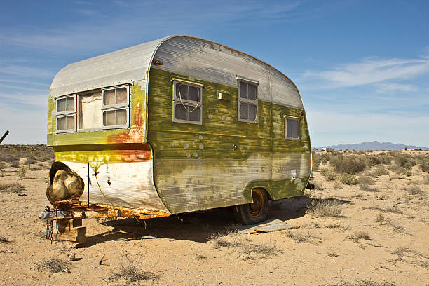 Abandoned Trailer in Desert Abandoned trailer in Desert on Arizona Mexico Border. trailer park stock pictures, royalty-free photos & images