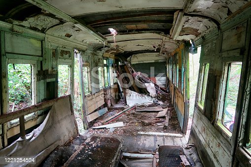 The wrecked interior of an old railway carriage, at a steam train graveyard in Kent.