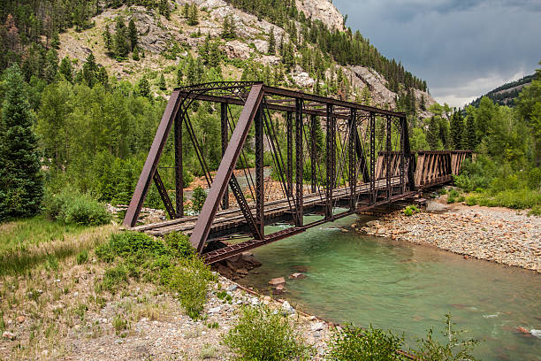 """Abandoned Train Trestle over Animas River """"old, abandoned train trestle over the Animas River in mountains of southwest Colorado between Durango and Silverton"""" animas river stock pictures, royalty-free photos & images"""