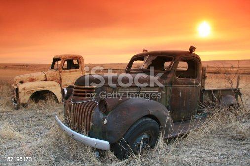istock Abandoned Trucks on the Prairie With Sunrise 157195173