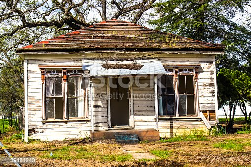 Abandoned Uninhabitable One Level House In Disrepair
