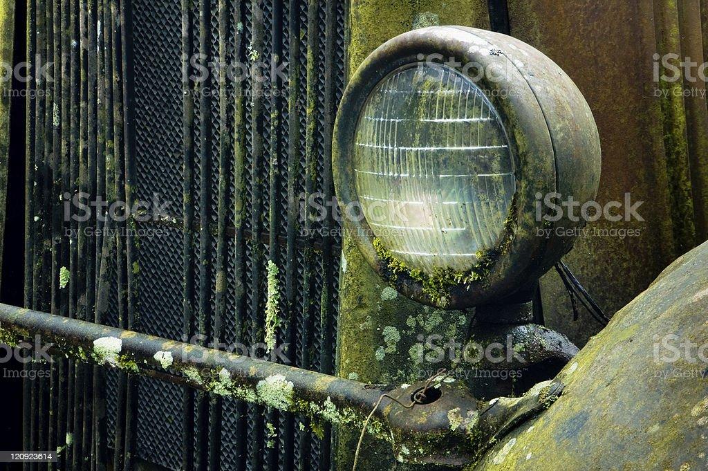 Abandoned vehicle headlight stock photo