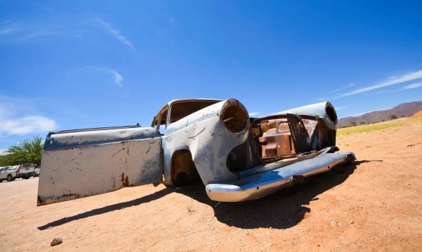 Abandoned vehicles sit in the desert outside Solitaire in Namibia. stock photo