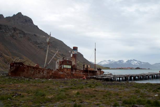 abandoned vessel neat pier stock photo