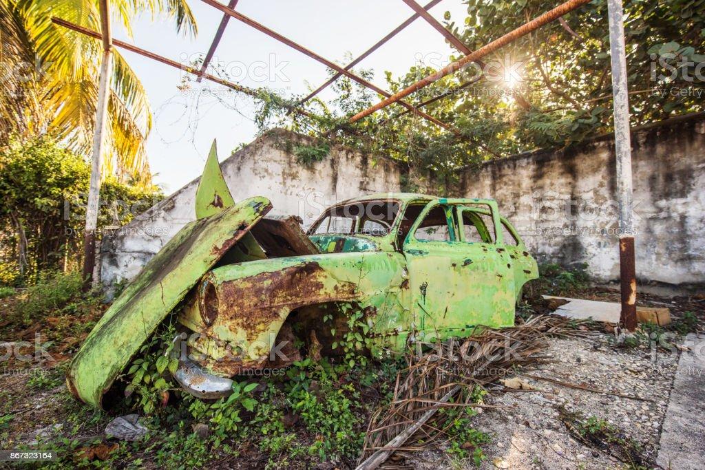 Abandoned vintage car, Cuba stock photo