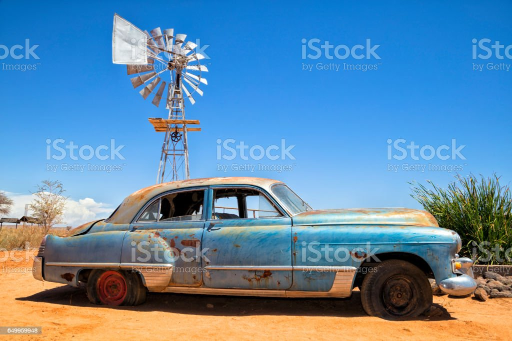 Abandoned vintage car in the desert stock photo