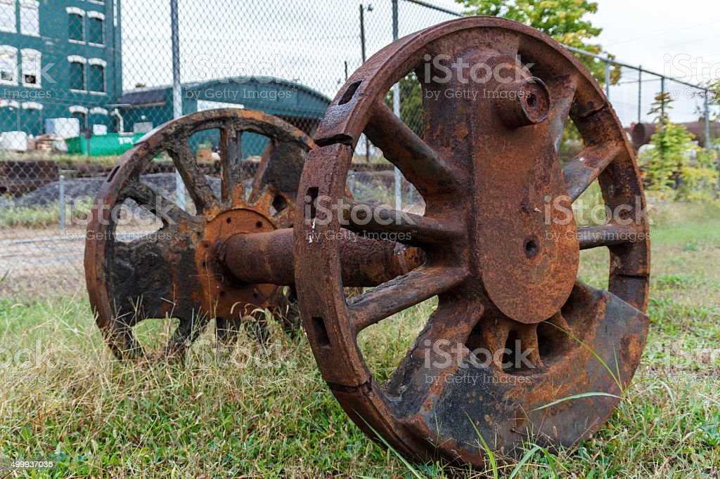Abandoned wheels from a steam powered locomotive. stock photo